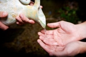 helping-others-water-hands