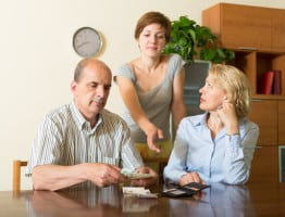 Adult daughter asking mature parents for money at home